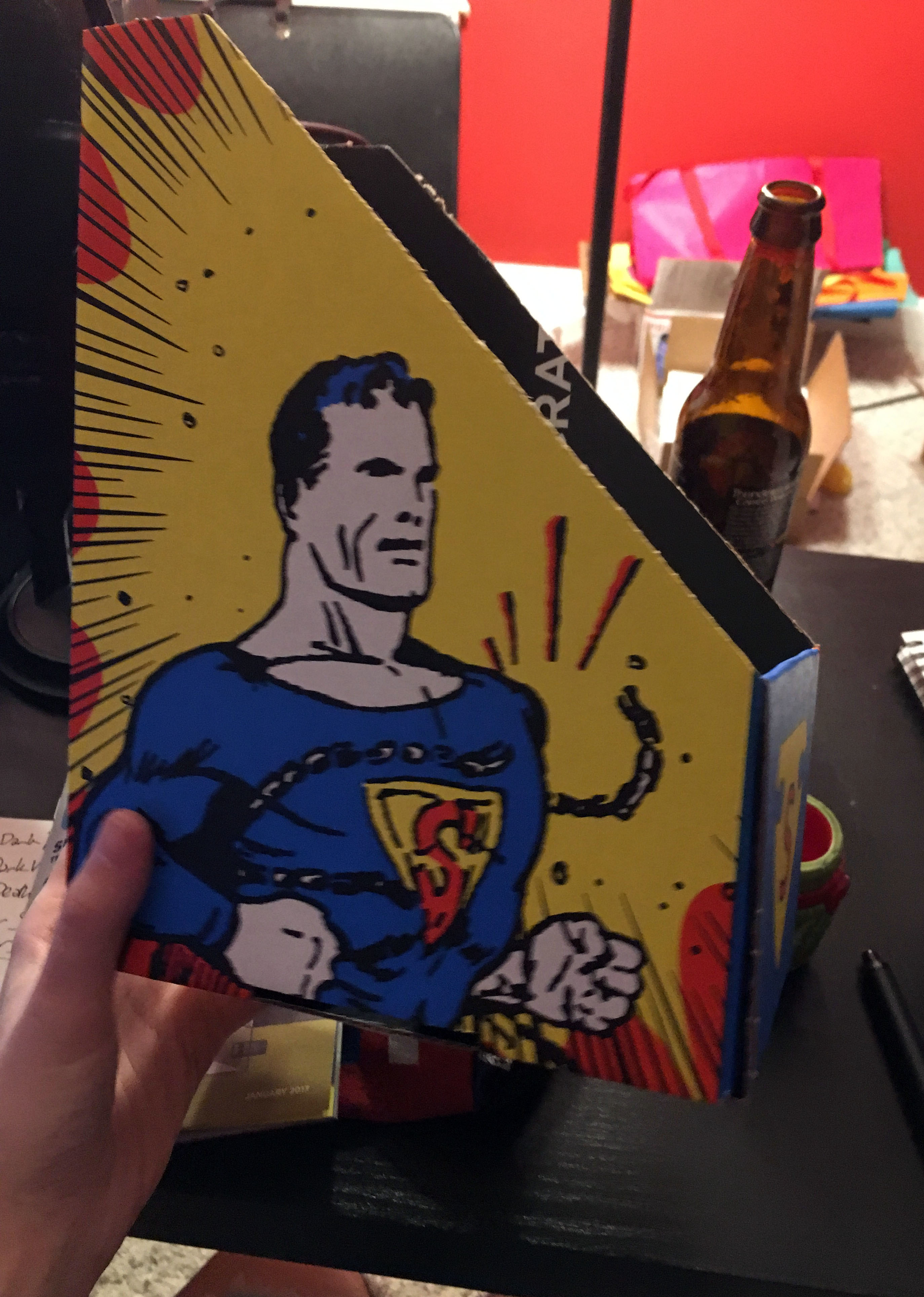 You could turn the box into a comics holder!